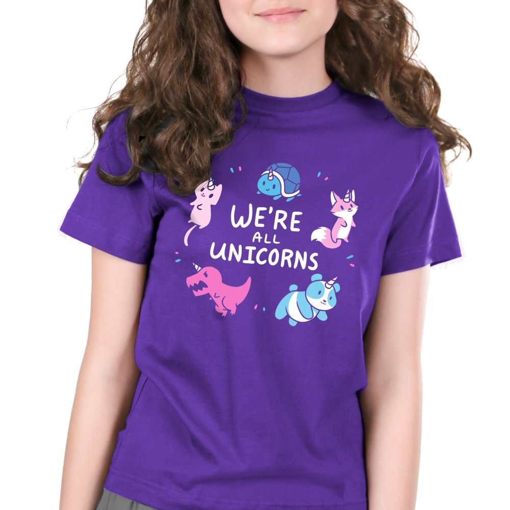 We're All Unicorns Women's Kids's T-shirt Model TeeTurtle purple t-shirt featuring several animals with unicorn horns including a panda, dinosaur, fox, cat, and turtle all surrounding shirt text