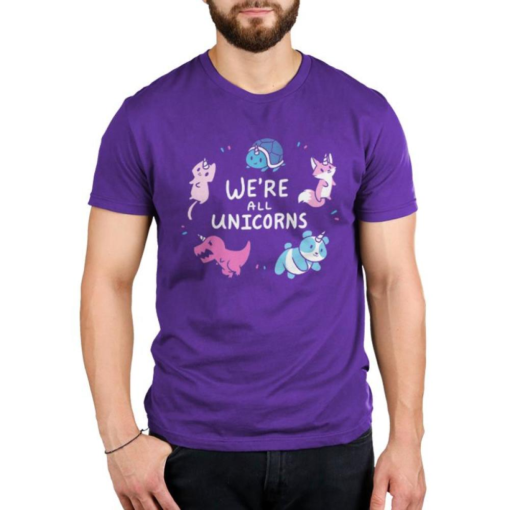 We're All Unicorns Men's T-shirt Model TeeTurtle purple t-shirt featuring several animals with unicorn horns including a panda, dinosaur, fox, cat, and turtle all surrounding shirt text