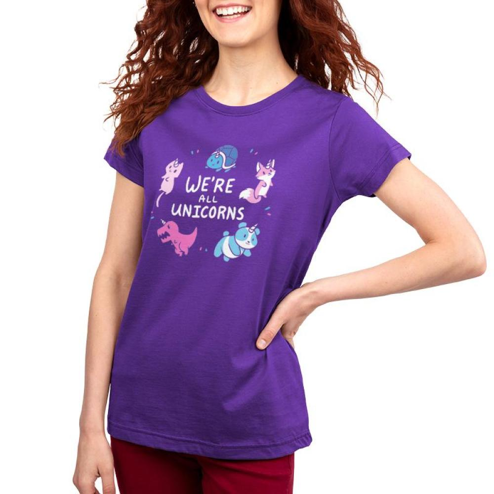 We're All Unicorns Women's T-shirt Model TeeTurtle purple t-shirt featuring several animals with unicorn horns including a panda, dinosaur, fox, cat, and turtle all surrounding shirt text