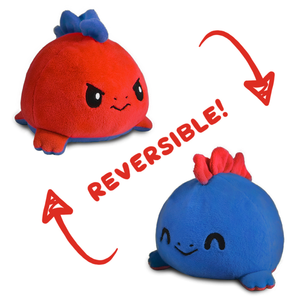 Reversible Stego (Red/Blue) plushie featuring a stuffed animal Stego with one side in the color blue looking happy and when flipped, it is red and angry